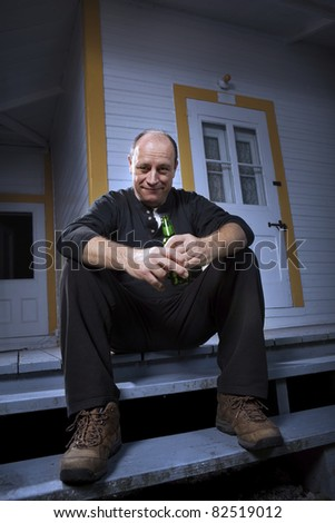 Man enjoying a beer on his front porch - Dark Mood