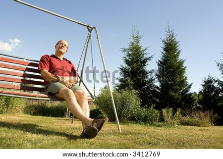 Man enjoying a summer day in a swing