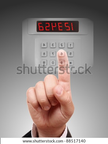 Man entering safe or door code