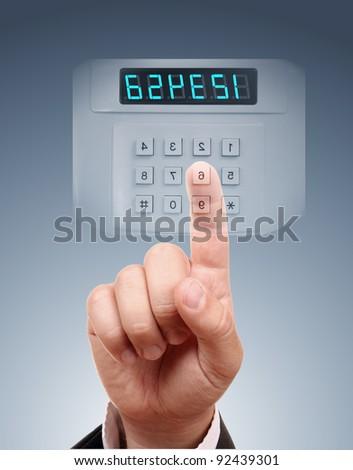 Man entering safe or door code