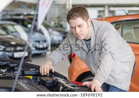 Man examining new car at the dealership. #189698192