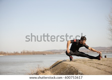 Man exercising by the river