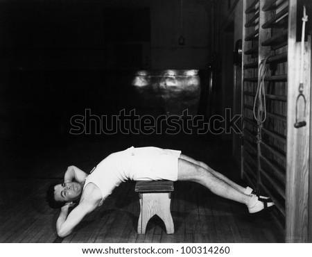 Man exercising on bench