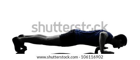 man exercising workout fitness aerobics posture in silhouette studio isolated on white background