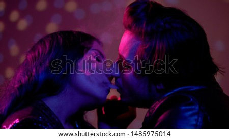 Man exhaling e-cigarette smoke in womans mouth, seducing for one night sex #1485975014