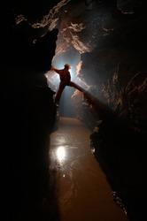Man exploring a cave