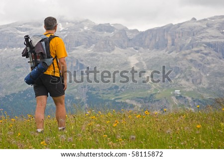 Man exploring Dolomites, Italy. Sella Group in the background.