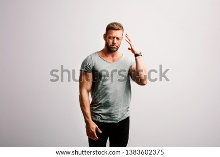 Man expressing his disgust with frown facial expression. Standing on white background #1383602375