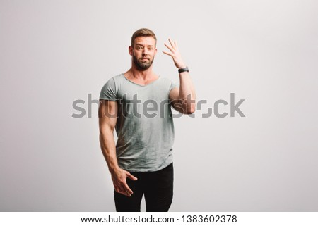 Man expressing his disgust with frown facial expression. Standing on white background #1383602378