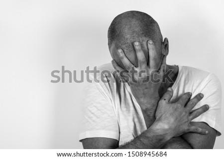 man expressing sad emotions, black and White image