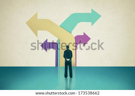 Man Facing  Flat Colored Arrows Pointing towards Different  Directions