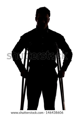 Man facing the camera with broken leg in silhouette isolated over white background  - stock photo