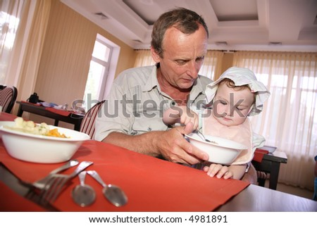man feeds the child