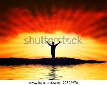 Man figure on sunshine with red sky background. Symbol of faith.