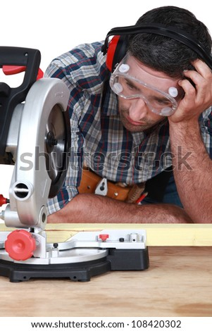 Man figuring out how to use saw