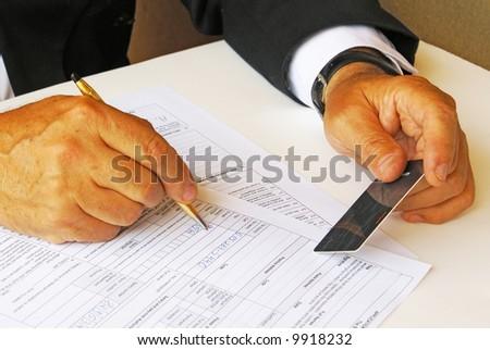 Man filling credit card data
