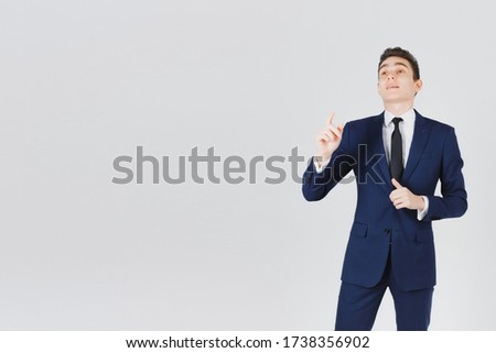 Man finds finger air blank open positive elegant suit business beautiful slender thin brunette white collar doit to select options solution answer search Stock photo ©