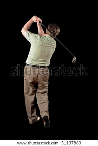 Man finishing his golf swing on a black background.