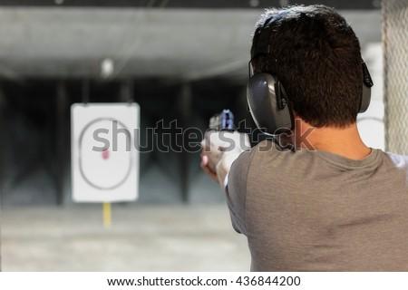 man firing usp pistol at target ...