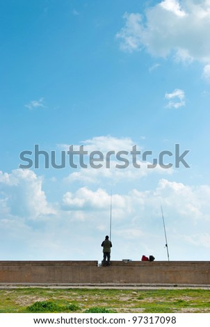 man fishing at the dock