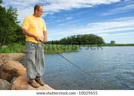 Man fishing by the sea