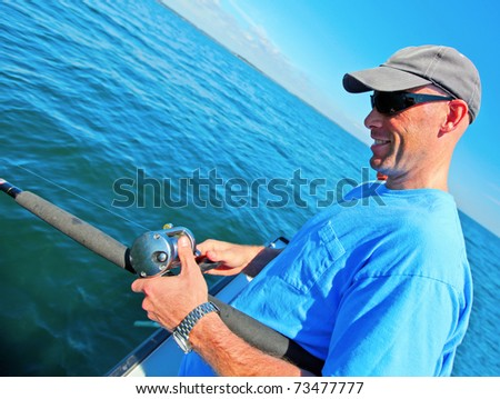 Man fishing from a boat in the ocean