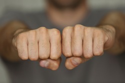 Man fists with space for tattoo