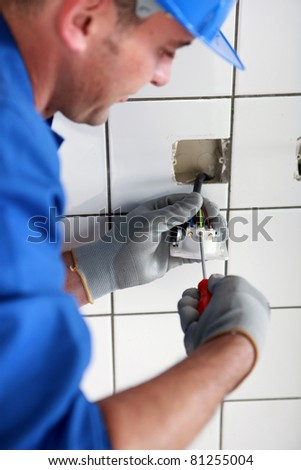 Man fitting an electric socket