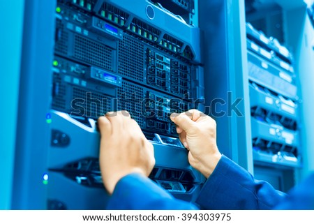 Man fix server network in data center room . #394303975