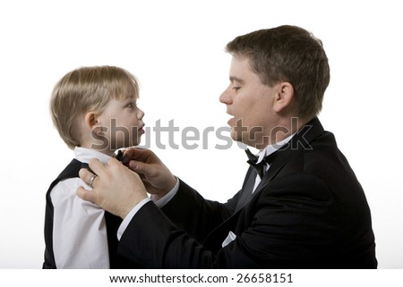 Man Fixing Boy's Bow Tie