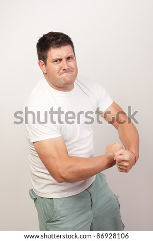 Man flexing his muscles