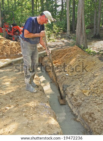 Man floating concrete foundation footer