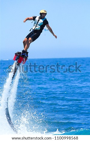 Man Flyboarding on  the Sea of Cabo San Lucas, Mexico