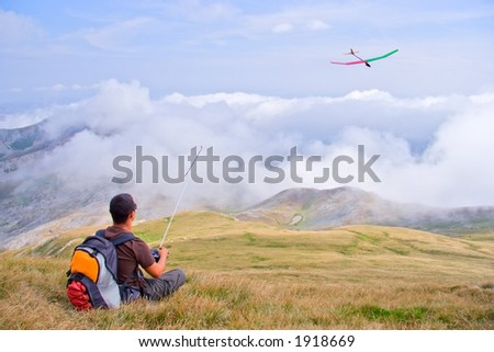 Man flying a plane from a top of the mountain Korab, Macedonia