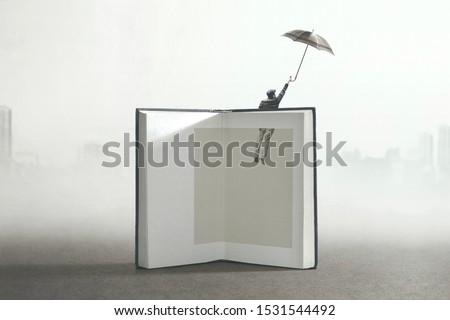 man flying out of a book; surreal concept