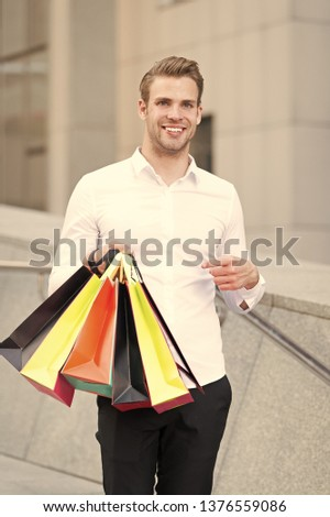 7559644a7d8c2 Man formal clothes carry shopping bags. Guy happy carry bunch shopping  bags. Profitable deals