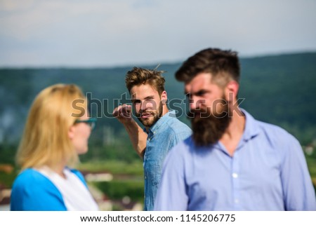 Man found or detected girlfriend cheating him walking with another man. Boyfriend full of jealous looks suspiciously at couple. Man aggressive going to attack lover of his girlfriend. Jealous concept. #1145206775