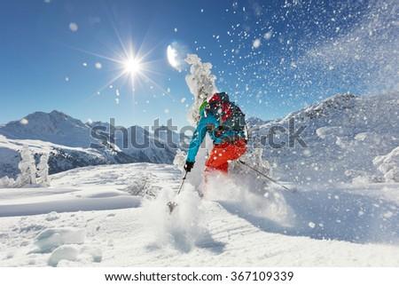 Man freerideer running downhill #367109339