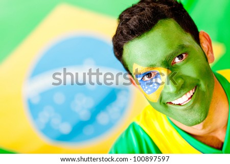 Man from Brazil with the flag painted on his face