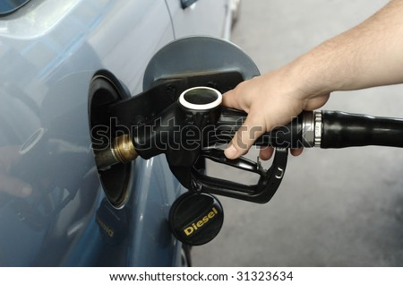 Man fueling car with diesel
