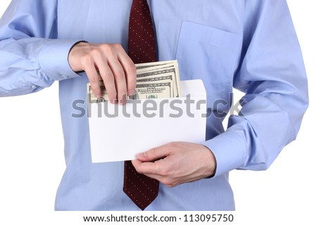 man gets out of the envelope dollars on white background close-up