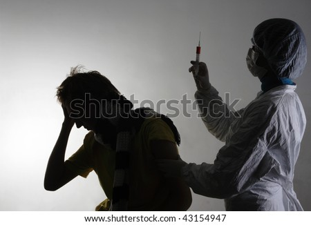 Man getting a flu shot from his doctor. Isolated on white, A(H1N1)