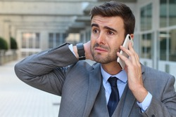 Man getting devastating news on a phone call