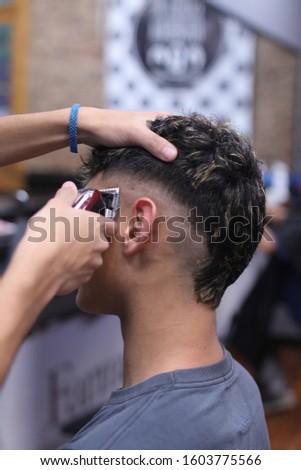 Man getting haircut with clipper