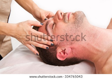 Man getting massage in thebeauty center #334765043