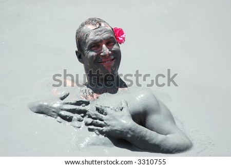 man getting mud-baths