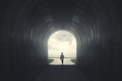 Man getting out from a dark tunnel