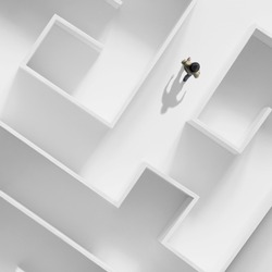 man getting out of a complex maze; surreal business concept