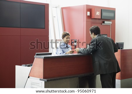Man getting ticket at airport