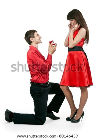 man gives the woman a ring on her knees - stock photo